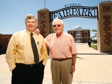 Scott Reed, left, and Jack Reed Sr. at the entrance to Tupelo's historic Fairpark district.